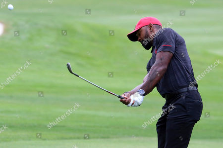 Former football player Charles Woodson hits onto the second green during the first round at the American Century Golf Championship, at the Edgewood Tahoe Golf Course in Stateline, Nev