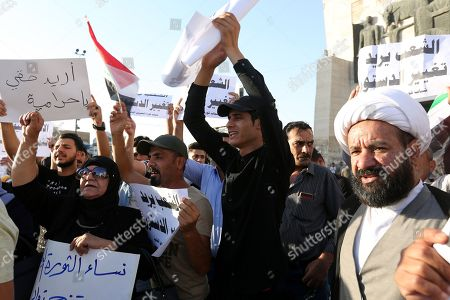 Iraqis carry banners and chant slogans during a demonstration at Tahrir square in central Baghdad, Iraq, 13 July 2018.  Thousands of Iraqis from various cities in southern Iraq and Baghdad, particularly in Basra, took to the streets to protest the lack of basic services and job opportunities and unemployment in the country, while the Iraqi Prime Minister Haider al-Abadi arrived in Basra to restore calm in the southern city, which has been gripped by protests for several days.