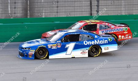 Elliott Sadler (1) attempts to hold off BJ McLeod (15) during a NASCAR Xfinity Series auto race at Kentucky Speedway, in Sparta, Ky