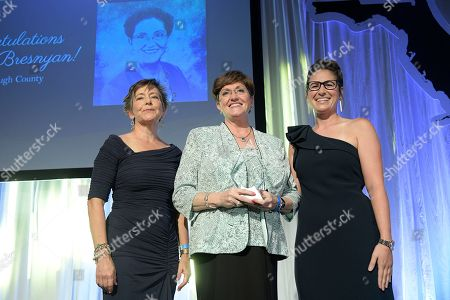 Connie Smith, Bonnie Bresnyan, Samantha Hopper. Bonnie Bresnyan, of Hillsborough County, center, is presented with the Mary J. Brogan Excellence in Teaching Award during the Florida Department of Education's 2019 Teacher of the Year Gala, in ChampionsGate, Fla. Presenting the award are Connie Smith, left, of Wells Fargo, and 2017 award winner Samantha Hopper