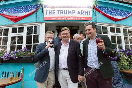 Stock Photo of David Campbell Bannerman MEP (centre) at the Donald Trump special relationship evening and welcome party held at  the Trump Arms Pub (formerly known as Jameson Pub) in Hammersmith, west London. The pub has been decked out with American flags and banners celebrating Donald Trump's arrival in the UK..