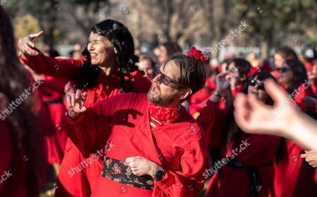 Participants in the 'Most Wuthering Heights Day Ever' dance, to Kate Bush's song Wuthering Heights, in the Edinburgh Gardens, Melbourne, Australia, 14 July 2018. The annual event sees people gather dressed as British singer, Kate Bush, dance to her 1978 song Wuthering Heights.
