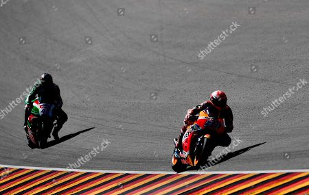 Spanish Moto GP rider Marc Marquez (R) of Repsol Honda Team and British MotoGP rider Scott Redding of Ducati Pramac in action during a free practice session of the motorcycling Grand Prix of Germany at the Sachsenring racing circuit in Hohenstein-Ernstthal, Germany, 14 July 2017. The Motorcycling Grand Prix of Germany takes place on 15 July.