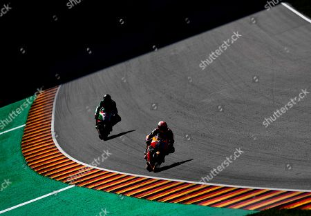 Spanish Moto GP rider Marc Marquez (L) of Repsol Honda Team and  British MotoGP rider Scott Redding of Ducati Pramac in action during a free practice session of the motorcycling Grand Prix of Germany at the Sachsenring racing circuit in Hohenstein-Ernstthal, Germany, 14 July 2017. The Motorcycling Grand Prix of Germany takes place on 15 July.