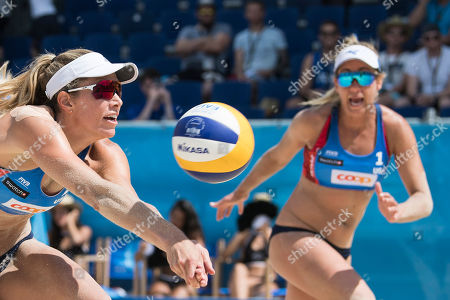 Alexandra Klineman of the USA, left, in action next her teammate April Ross of the USA during the women's quarter final game at the Beachvolley Worldtour Major Series, on Saturday, July 14, 2018 in Gstaad, Switzerland.