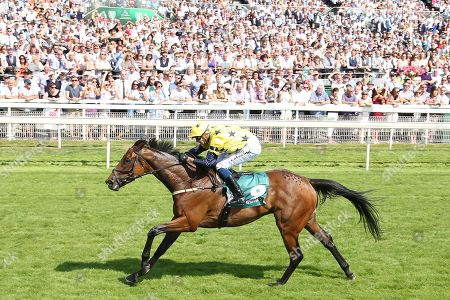 EUCHEN GLEN (9) ridden by jockey Alistair Rawlinson, trained by Jim Goldie and owned and bred by Mr W M Johnstone winning the 59th running of The John Smiths Heritage Handicap over 1m 2f (£200,000) at York Racecourse, York. Picture by Mick Atkins