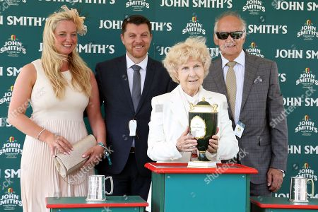 The Presentation after EUCHEN GLEN (9) ridden by jockey Alistair Rawlinson, trained by Jim Goldie and owned and bred by Mr W M Johnstone won the 59th running of The John Smiths Heritage Handicap over 1m 2f (£200,000) at York Racecourse, York. Picture by Mick Atkins