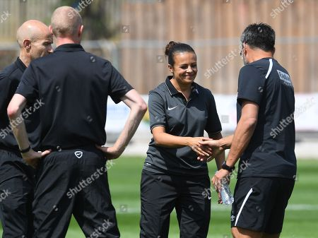Stock Photo of David Wagner manager of Huddersfield Town shakes hands with assistant referee Lisa Rashid before kick off
