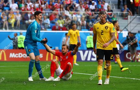 2ddb481a37e Belgium goalkeeper Thibaut Courtois helps Harry Kane of England to his feet