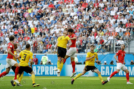Belgium's Toby Alderweireld, left, and England's Harry Maguire go for a header during the third place match between England and Belgium at the 2018 soccer World Cup in the St. Petersburg Stadium in St. Petersburg, Russia