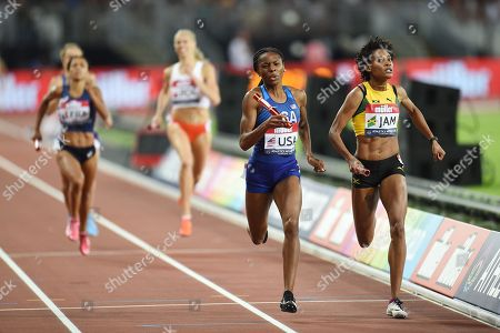 Courtney Okolo of the USA team crosses the line ahead of  Stephanie Ann McPherson of Jamaica team to win the Women's 4x400m Relay