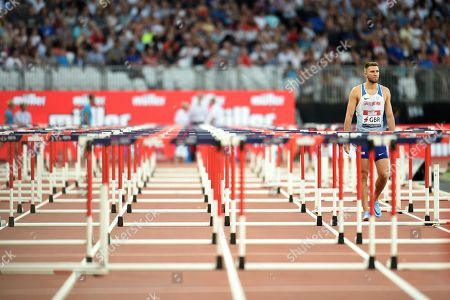 Andrew Pozzi of Great Britain looks dejected after crashing out of the mens 110m hurdles final.