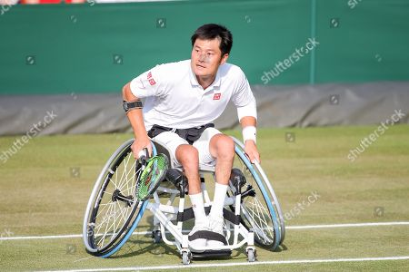Stock Photo of Shingo Kunieda (JPN) - Tennis : Shingo Kunieda of Japan during the Men's wheelchair doubles semi-final match of the Wimbledon Lawn Tennis Championships against Alfie Hewett and Gordon Reid of Great Britain at the All England Lawn Tennis and Croquet Club in London, England.
