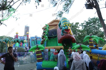 Stock Image of Children play in a bouncy bounce as they visit the 'al-Sham Gathers us' marketing festival held in the Tishreen public park in Damascus, Syria, 14 July 2018. The event was held by the Damascus Governorate with the cooperation of the ministry of tourism
