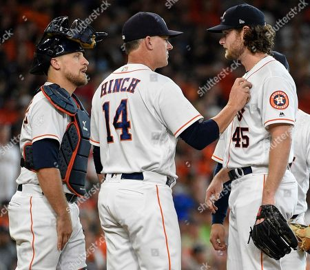 Houston Astros starting pitcher Gerrit Cole (45) is removed from a baseball game by manager AJ Hinch (14) as catcher Tim Federowicz watches during the sixth inning of a baseball game against the Detroit Tigers, in Houston