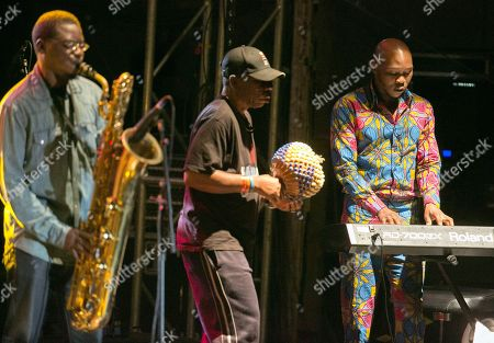 The Nigerian singer Seun Kuti (R) and his group 'Egypt 80' performs during a concert at the Festival Pirineos Sur, which celebrates its 27th edition on the floating stage of the reservoir of Lanuza, in Huesca, Spain, 14 July 2018.