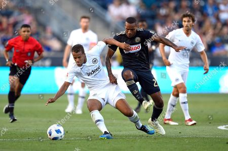 Stock Picture of Eintracht Frankfurt's Timothy Chandler, left, and Philadelphia Union's Jay Simpson collide during the first half of an international friendly soccer match, in Chester, Pa