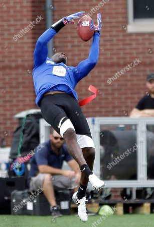 Ocho's Chad Ochocinco catches a pass during a championship game against Godspeed at the American Flag Football League (AFFL) U.S. Open of Football tournament, in Indianapolis