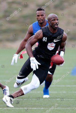 Stock Photo of Godspeed's Jason Avant runs with the ball during a championship game against Ocho at the American Flag Football League (AFFL) U.S. Open of Football tournament, in Indianapolis