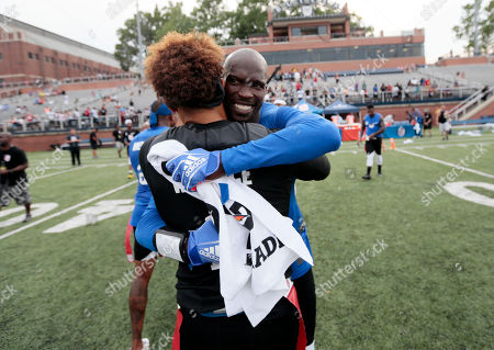Chad Ochocinco, Seneca Wallace. Ocho's Chad Ochocinco, right, and Godspeed's Seneca Wallace embrace after Goodpeed won the championship game at the American Flag Football League (AFFL) U.S. Open of Football tournament, in Indianapolis