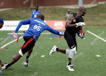 Stock Picture of Chad Ochocinco, Jason Avant. Ocho's Chad Ochocinco, left, pulls the flag of Godspeed's Jason Avant during a championship game at the American Flag Football League (AFFL) U.S. Open of Football tournament, in Indianapolis
