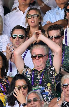 Chris Evans stretching on Centre Court, Kate Winslet sits behind