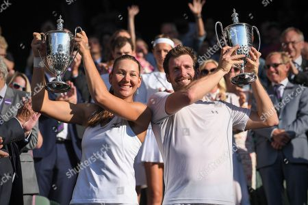 Stock Picture of Alexander Peya and Nicole Melichar celebrate victory with the trophy in the Mixed Doubles final