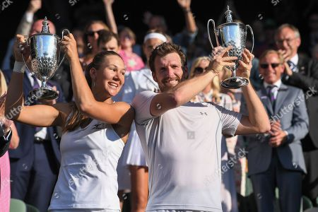 Alexander Peya and Nicole Melichar celebrate victory with the trophy in the Mixed Doubles final