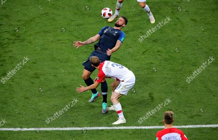 Olivier Giroud of France controls the ball as Ivan Strinic of Croatia challenges