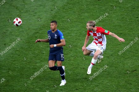 Ivan Strinic of Croatiaa clears from Kylian Mbappe of France