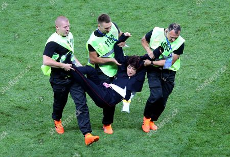 Pussy Riot protesters invade the pitch during the World Cup final and are forcibly removed by security