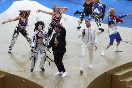 US singer Nicky Jam (C), US singer and actor Will Smith (R) and Kosovar singer Era Istrefi (L) perform during the closing ceremony before the FIFA World Cup 2018 final between France and Croatia in Moscow, Russia, 15 July 2018.