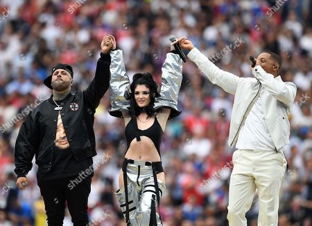 US singer Nicky Jam (L), US singer and actor Will Smith (R) and Kosovar singer Era Istrefi perform during the closing ceremony before the FIFA World Cup 2018 final between France and Croatia in Moscow, Russia, 15 July 2018.