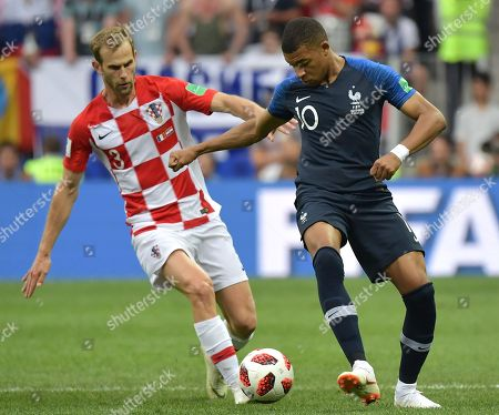Ivan Strinic (L) of Croatia and Kylian Mbappe of France in action during the FIFA World Cup 2018 final between France and Croatia in Moscow, Russia, 15 July 2018. (RESTRICTIONS APPLY: Editorial Use Only, not used in association with any commercial entity - Images must not be used in any form of alert service or push service of any kind including via mobile alert services, downloads to mobile devices or MMS messaging - Images must appear as still images and must not emulate match action video footage - No alteration is made to, and no text or image is superimposed over, any published image which: (a) intentionally obscures or removes a sponsor identification image; or (b) adds or overlays the commercial identification of any third party which is not officially associated with the FIFA World Cup)