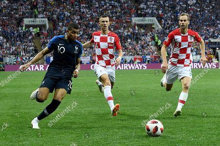 Kylian Mbappe of France, Ivan Perisic of Croatia and Ivan Strinic of Croatia