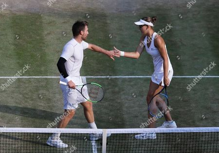 Nicole Melichar, right, of the United States and Austria's Alexander Peya, touch hands during the mixed doubles final match against Britain's Jamie Murray and Victoria Azarenka of Belarus, at the Wimbledon Tennis Championships, in London