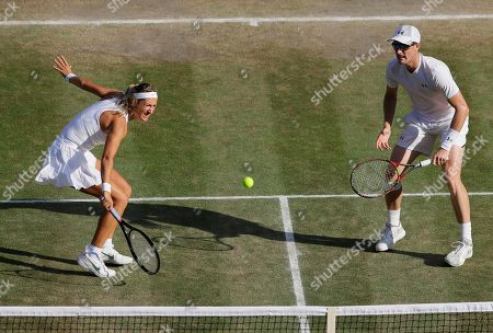 Britain's Jamie Murray and Victoria Azarenka of Belarus return the ball to Nicole Melichar of the United States and Austria's Alexander Peya during the mixed doubles final match, at the Wimbledon Tennis Championships, in London