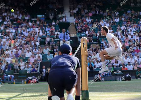 Nicole Melichar of the United States and Austria's Alexander Peya, jumping neat the net, return the ball to Britain's Jamie Murray and Victoria Azarenka of Belarus during the mixed doubles final match, at the Wimbledon Tennis Championships, in London