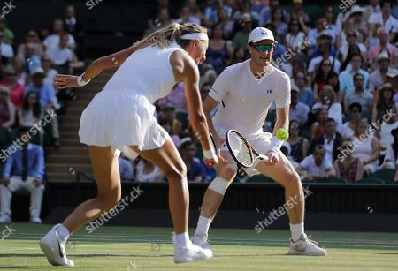 Nicole Melichar, left, of the United States and Austria's Alexander Peya return the ball to Britain's Jamie Murray and Victoria Azarenka of Belarus during the mixed doubles final match, at the Wimbledon Tennis Championships, in London
