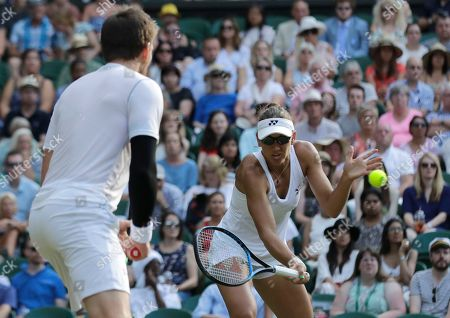 Nicole Melichar, right, of the United States and Austria's Alexander Peya return the ball to Britain's Jamie Murray and Victoria Azarenka of Belarus during the mixed doubles final match, at the Wimbledon Tennis Championships, in London