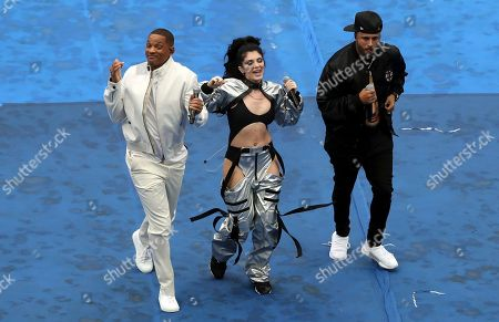 U.S. actor Will Smith, Kosovo singer Era Istrefi, and singer Nicky Jam, from left, perform during a ceremony before the final match between France and Croatia at the 2018 soccer World Cup in the Luzhniki Stadium in Moscow, Russia