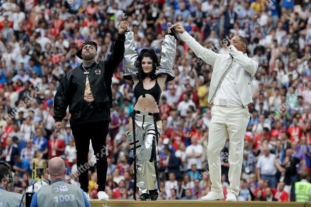 Singers Nicky Jam, left, Era Istrefi, center, and Will Smith, left, perform during the closing ceremony prior to the final match between France and Croatia at the 2018 soccer World Cup in the Luzhniki Stadium in Moscow, Russia