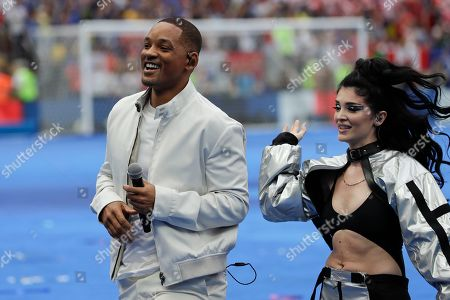 Singers Will Smith, left, and Era Istrefi, right, perform during the closing ceremony prior to the final match between France and Croatia at the 2018 soccer World Cup in the Luzhniki Stadium in Moscow, Russia
