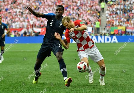 France's Paul Pogba, left, and Croatia's Ivan Strinic challenge for the ball during the final match between France and Croatia at the 2018 soccer World Cup in the Luzhniki Stadium in Moscow, Russia