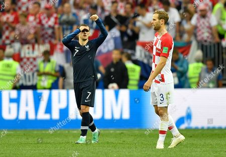 France's Antoine Griezmann celebrates beside Croatia's Ivan Strinic, right, after scoring his side's second goal during the final match between France and Croatia at the 2018 soccer World Cup in the Luzhniki Stadium in Moscow, Russia
