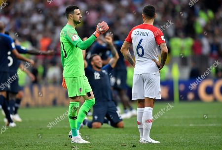 Croatia goalkeeper Danijel Subasic, left, comforts his teammate Dejan Lovren after losing the final match between France and Croatia at the 2018 soccer World Cup in the Luzhniki Stadium in Moscow, Russia