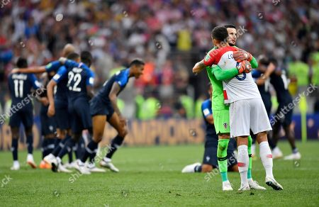 Croatia goalkeeper Danijel Subasic hugs Croatia's Dejan Lovren after losing the final match between France and Croatia at the 2018 soccer World Cup in the Luzhniki Stadium in Moscow, Russia