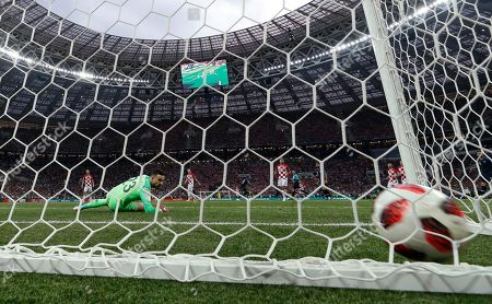 Croatia goalkeeper Danijel Subasic looks to the ball after France's Kylian Mbappe scored his side's fourth goal during the final match between France and Croatia at the 2018 soccer World Cup in the Luzhniki Stadium in Moscow, Russia