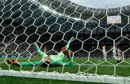 Croatia goalkeeper Danijel Subasic reacts after France's Paul Pogba scored his side's third goal during the final match between France and Croatia at the 2018 soccer World Cup in the Luzhniki Stadium in Moscow, Russia