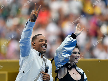 Will Smith and Era Istrefi, right, perform prior to the final match between France and Croatia at the 2018 soccer World Cup in the Luzhniki Stadium in Moscow, Russia